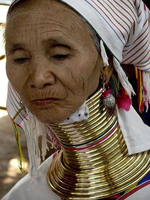 Long-necked woman  This woman belongs to the Padaung tribe of Myanmar's ethnic minority Karen.  by Marina & Enrique