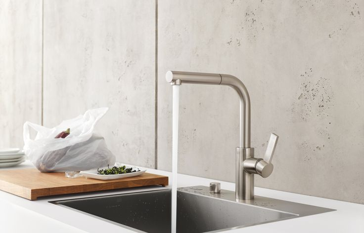Simple kitchen faucet with pull-out spout by Dornbracht / Elio Collection