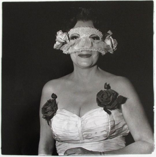 """""""Lady at a Masked Ball with Two Roses on Her Dress, N.Y.C."""" It was taken in 1967…"""