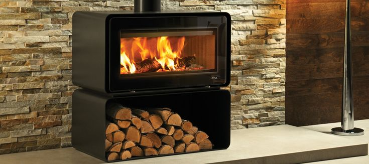 The Lotus Living Base wood burning fire creates a breathtaking view on top of its elegant base.