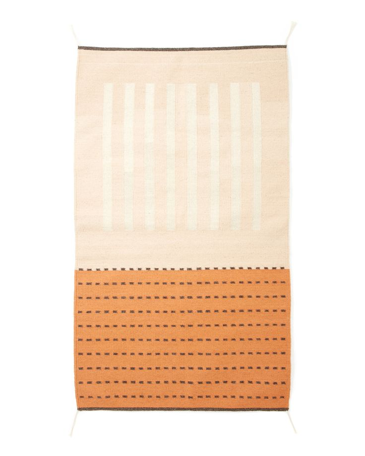 Understated and intuitive, The Agnes Rug in Peach was inspired by the minimalist work of Agnes Martin. Handwoven in a small village in Oaxaca, Mexico. Makes a great addition to any space. Due to the n