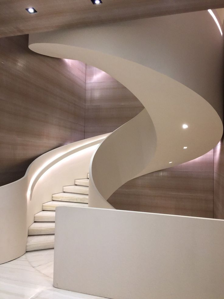 Elegant white curved staircase