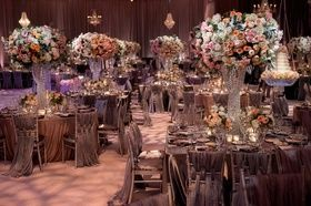 Crystal Strand Centerpiece Stands    Photography: Handeland Tesoro Photography   Read More:  http://www.insideweddings.com/weddings/alfresco-jewish-wedding-ceremony-lush-reception-in-san-diego/784/