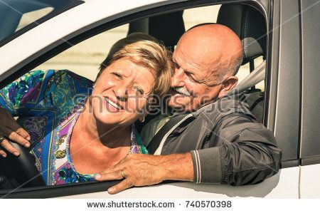 Happy senior couple having fun driving car trip on the road - Joyful active elderly concept with retired man and woman enjoying best years - Modern mature travel lifestyle on retirement time mood