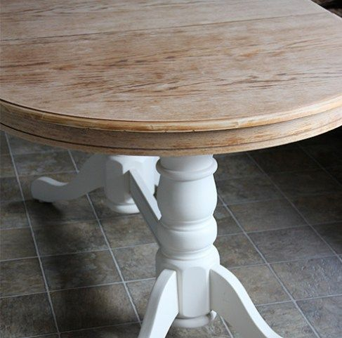 DIY: Refinish a dining table. Fresh Crush refinished a oak dining table with a painted base and a refinished and stained wood top. See the makeover!