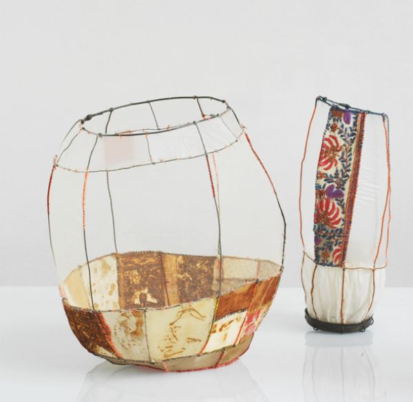 I really like this vessel, it looks like a vase and has material on it, so the person who actually made it, took wire vesseling to another level and experimented with fabrics. Which gives it great effects. I think that it looks simple but really attractive as a vase, because of its warm colours and historic feel.