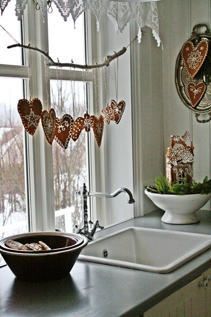 hearts on a simple branch in a kitchen window natural crafts swedish christmas decorationschristmas ideaschristmas