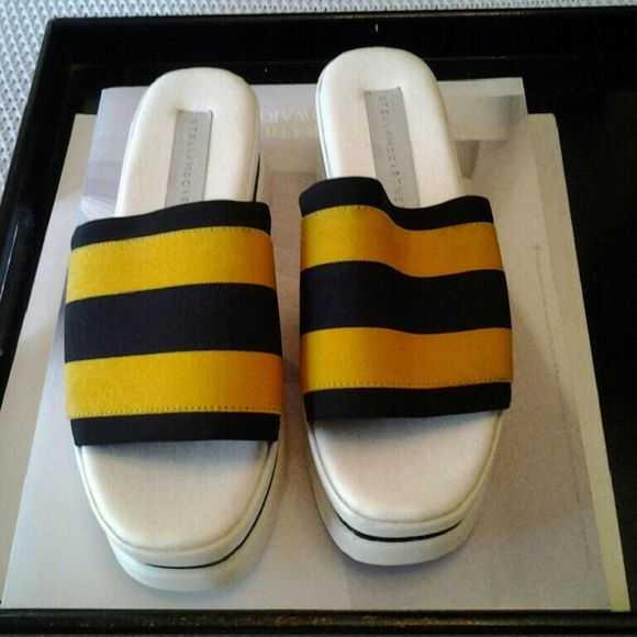 STELLA  McCARTNEY PLATFORM SLIDES Black and yellow Stella McCartney platcform slides , with white platform Like wear throughout shoes..still in very good condition . Stella McCartney Shoes Wedges