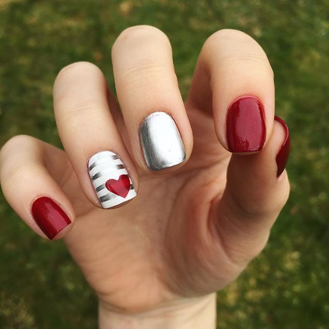 "It's February! Which means it's the month of love  or at least for the next two weeks! This design was inspired by a mani that @nail_ppolished did. Hers was way better of course! I'd check her out if I were you! I'm so excited to all of y'all's Valentine nails!  Products used:  Essie Base Coat  Sally Hansen ""White On"" and ""Cinna-snap""  Essie ""No Place Like Chrome""  Sally Hansen quick dry top coat  #nails #nailart #nailartistry #nailsofinstagram #naildesign #nailpolish #nailsoftheday…"