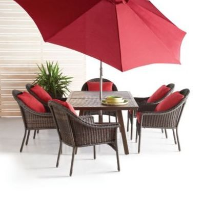 Create a casual ambience and take dinner outside. Love the rich red colours of this patio umbrella and cushions!