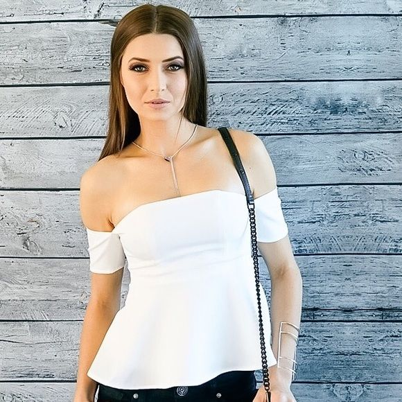 ❌CLEARANCE! OFF THE SHOULDER PEPLUM TOP Highlight your curves and mix things up in this cutting-edge white peplum flared top. Featuring a sexy shoulder cross-panel with short sleeves. A form-fitting silhouette that flares out at the hem creating a hourglass effect. Paired with a skinny jean or a pencil skirt - for both a night and evening look. Model is wearing a small. Top design for smaller bust sizes for best fit.  Off-the-shoulder Peplum Top Hem flare Short-sleeves Form-fitting top Style…