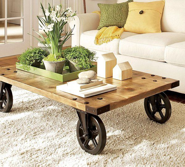 Modern style spicy with rustic table and rustic pots in which are flowers. Very elegant and desirable.
