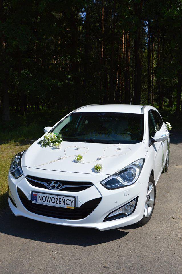 Dekoracje samochodu na ślub.