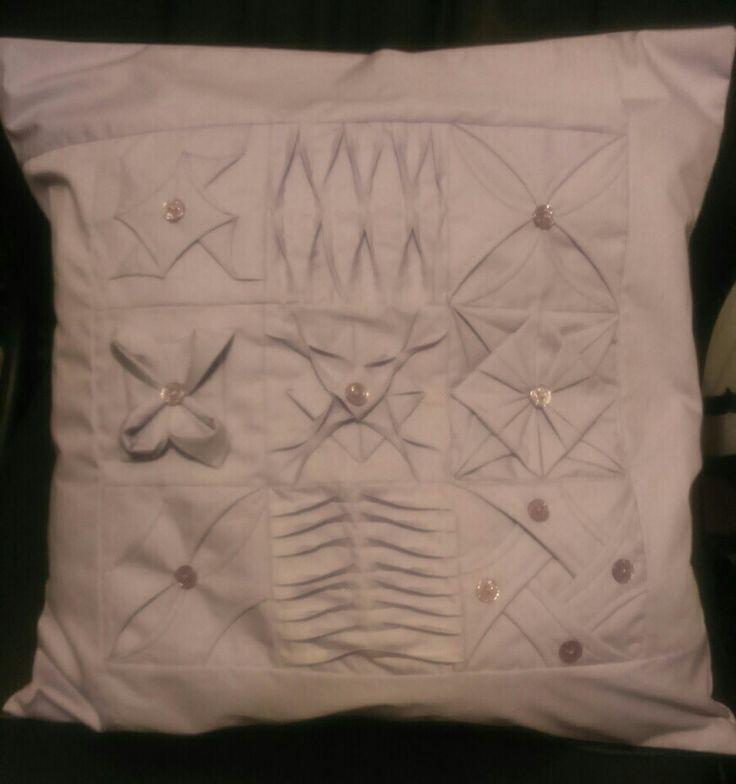 Finished cushion after Jenny Raiment class on folding fabric.