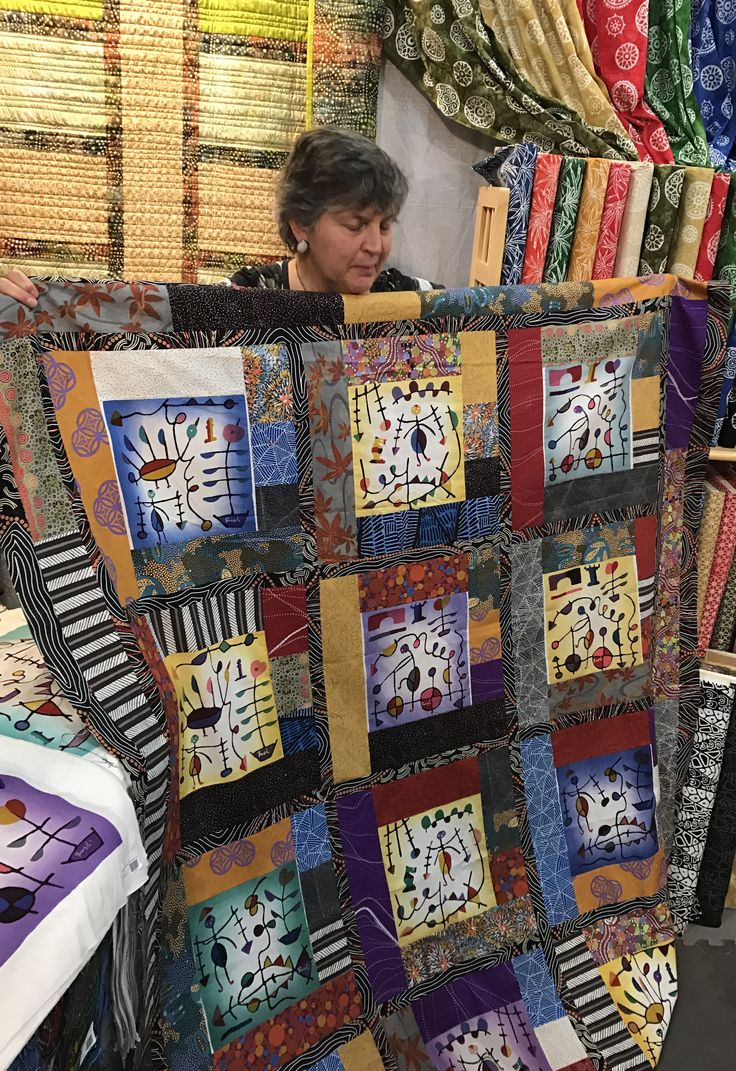 Judy Gula of Artistic Artifacts showing one of her quilt tops made with Batik Panels. #batik #artisticartifacts