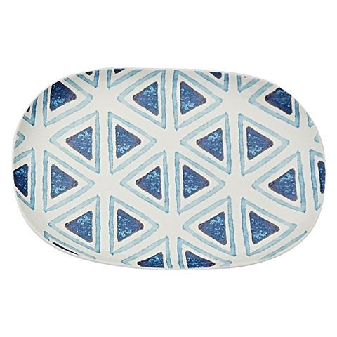 Embrace a wash of coastal colour at your dining table with the refreshing pattern and quality stoneware of the Palm Trees Sway Shape Shifter Serving Platter from TALULAH.
