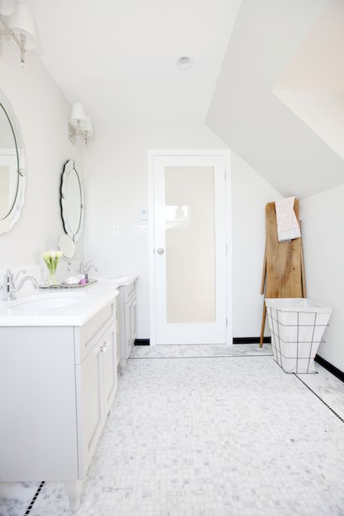 Love It Or List It   Stunning Master Bathroom With Frosted Glass Water  Closet Door Framed By Walls Painted Gray, Behr Silver Drop, Over White  Marble Tiled ...
