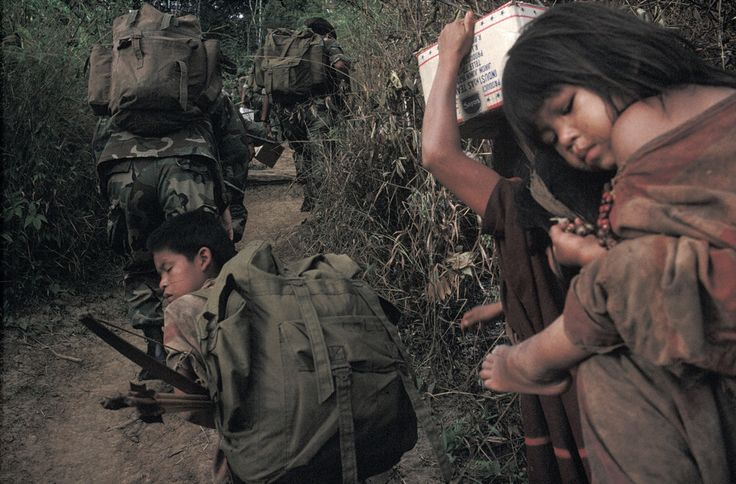 Alex Webb PERU. Approaching Ponchoni. 1993. Peruvian military with Ashaninka Indians.