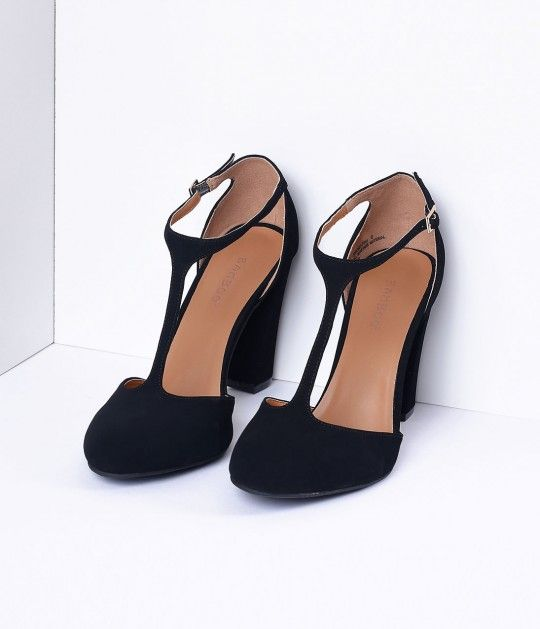 We never cease to amuse ourselves with these feminine retro T-straps. Soft and ladylike, the soft vegan friendly nubuck black heels are an elegant match to any vintage ensemble. Featuring a 4 pump, these beauties have an adjustable and gored buckle, roun