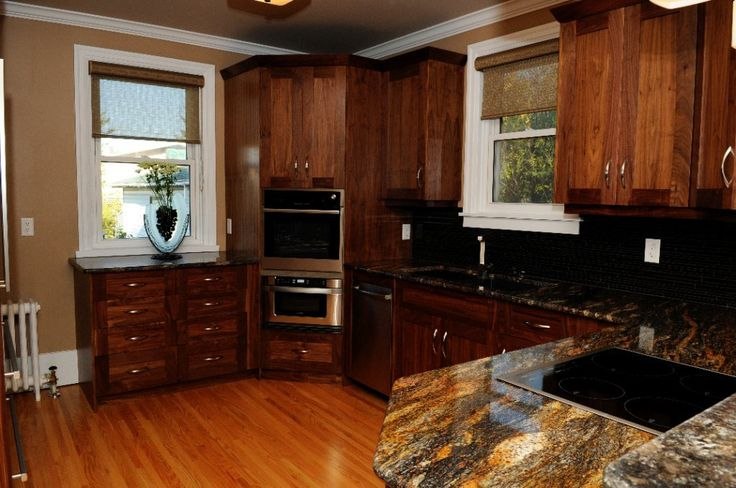 Cherry shaker cabinets, hardwood floors, granite counter tops, stainless steel appliances, under mount, Blanco, black sink, tile back splash.