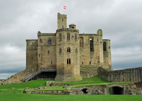 Warkworth Castle, Warkworth, Northumberland, England  http://www.castlesandmanorhouses.com/photos.htm  It is an example of a Norman Motte and bailey castle.  Both town and castle occupy a loop of the River Coquet, less than a mile from England's north-east coast.  Traditionally the castle's construction has been ascribed to Prince Henry of Scotland in the mid-12th century, but it may have been built by King Henry II of England when he took control of England's northern counties.