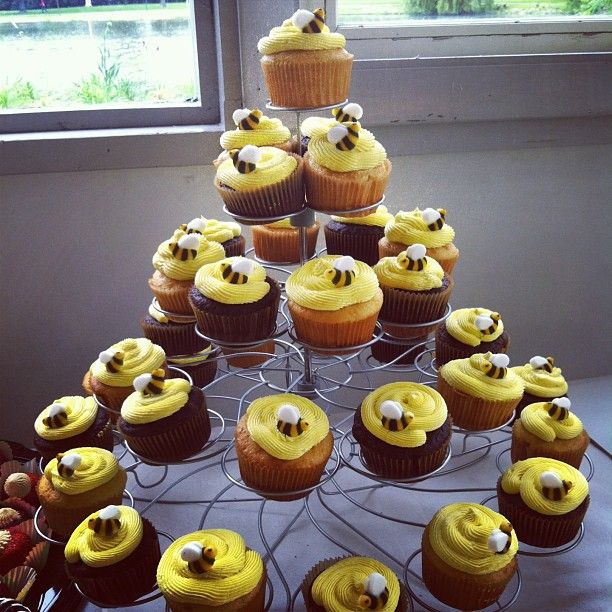 winnie the pooh baby shower for a vintage shower look. sugar bees ordered online look nice on the bee hive inspired cupcakes