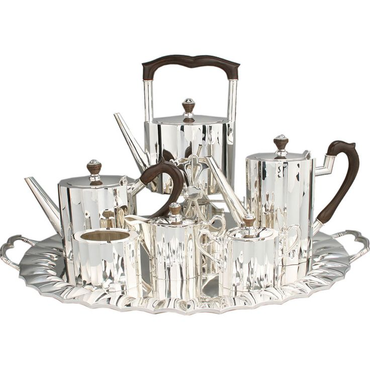 Sterling silver Art Deco coffee and tea set, Mexican, c. 1930's. The feel is heavy and luxurious. It consists of an under tray, tea pot, coffee pot, hot water pot with warmer, sugar, creamer and of course the waste pot.