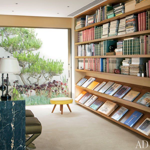 Library with space for magazine display: Steven Meisel Renovates a Midcentury House in Los Angeles : Architectural Digest