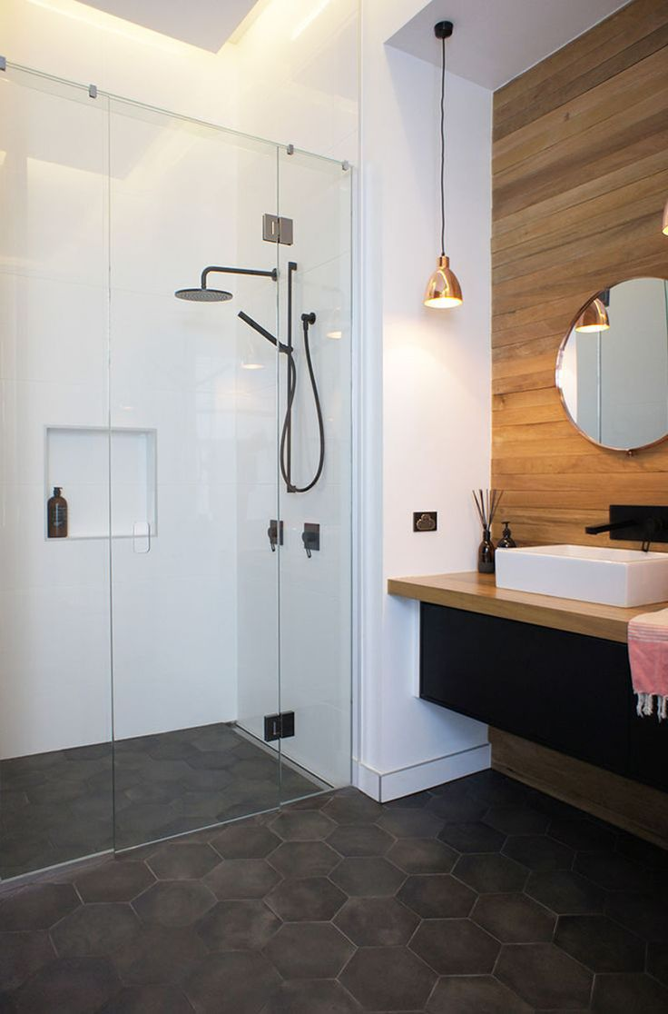 Bathroom Tile Ideas - Grey Hexagon Tiles | Dark grey hexagon tiles on this bathroom floor partnered with the wood paneled feature wall make the space feel modern and inviting.