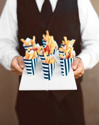 Guests snacked on french fries served in hand-folded apropos containers during the cocktail hour.