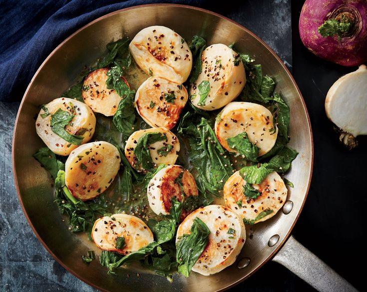 Braised Turnips with Greens   Winter white turnips peak from October through February. Like the tender baby turnips of late spring and summer, the smallest bulbs of this root vegetable yield delicate, sweet flavor. (Large turnips can be tough and woody.) Turnips are great candidates for a variety of cooking methods: roasting, braising, sautéing, and steaming. You can also thinly shave or julienne them to use raw in salads. Try this recipe to incorporate both bulb and greens in one dish.