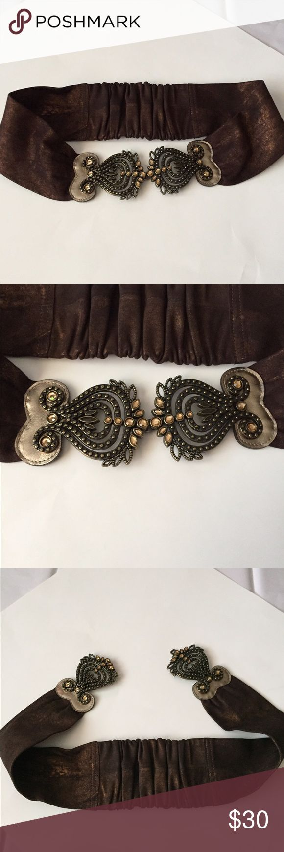 Chico's Stretch Rhinestone Belt! Chico's brown leather with gold sheen belt! Large rhinestone buckle! New without tags! Stretchy in the back for a perfect fit! Very Chic! 35.5 inches long. Width 4 inches. This is a M/L. Please refer to measurements. Chico's Accessories Belts