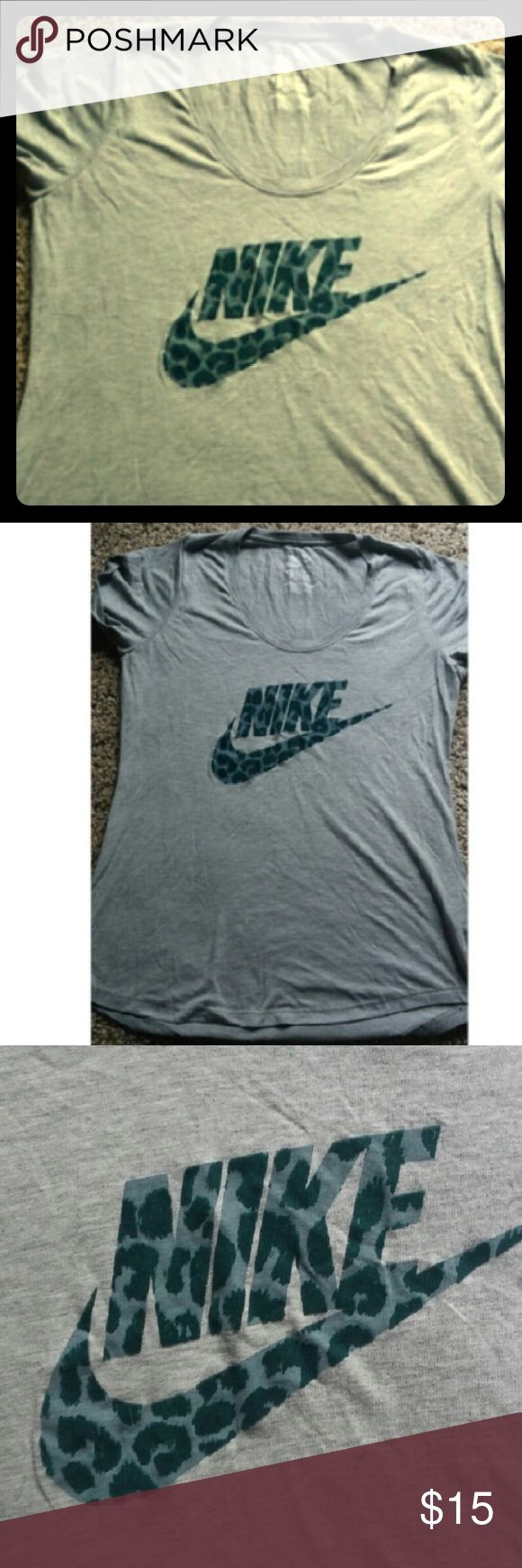 Nike Leopard Tee Nike Leopard Tee. Turquoise lettering with deep teal, flocked leopard spots. Scoop neck on light grey cotton. Nike Tops Tees - Short Sleeve