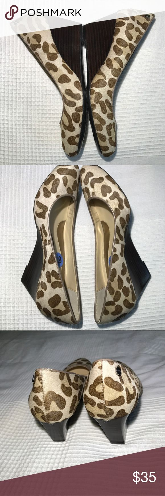 NWT Calvin Klein Leopard print wedges size 6 1/2 NWT Adorable abs on trend leopard print Calvin Klein wedges. Cow hair material. Please bundle to save or send me an offer. Thanks for stopping by Calvin Klein Shoes Wedges