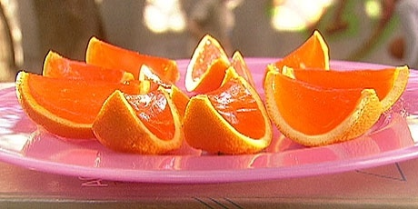 Orange slice jello shot jigglers:    Cut your oranges in half, and scoop out the fruit leaving you with two bowl shaped peels.    Make your jello mix just how you like it, and fill each orange bowl peel.    Put in fridge to set over night. Slice each orange half into thirds to make your slices and serve!
