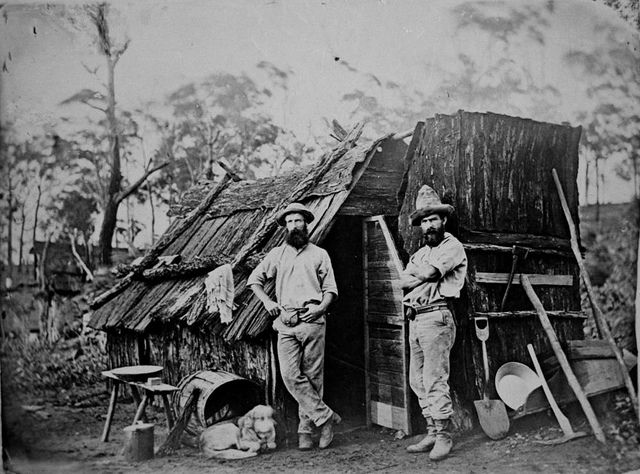 Gold miners outside a bark hut, Queensland. 1870. State Library of Queensland, Australia.
