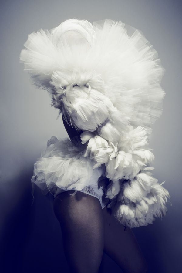 Soft Sculptural Fashion with layers of white feathers & tulle; artistic fashion photography; bird-inspired fashion design // Alexandra Konwinski