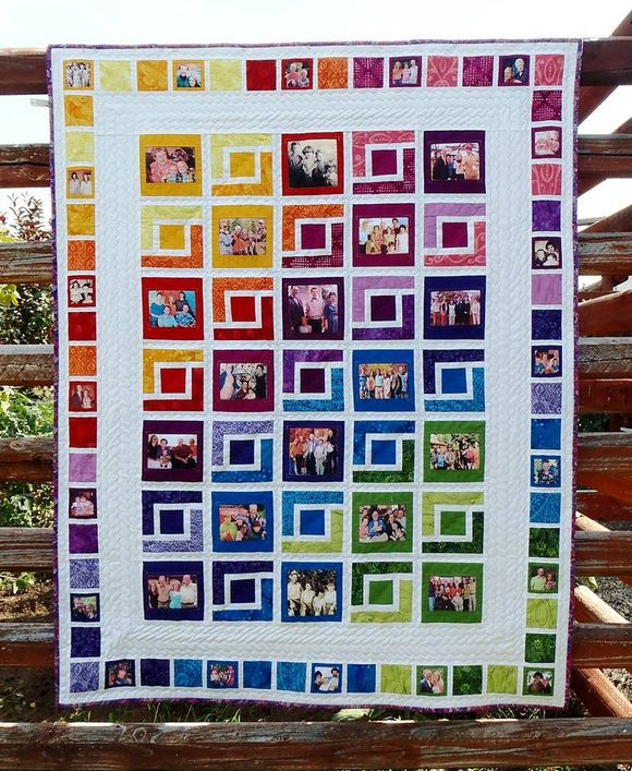 Julie Koch's memory quilt has been very popular with our readers.  The movement of color from yellow/orange through violet/blue and down to green, matching in the border, gives it a crisp look punctuated with the white. The family prints she's used also seem to blend into the movement of color and pattern.