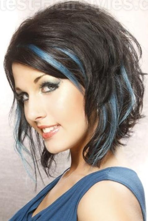 Wavy angled #bob with #layers and blue streaks. I like it because it's a fun look! #hair