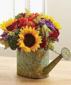 watering can with flowers...LOVE                                                                                                                                                     More