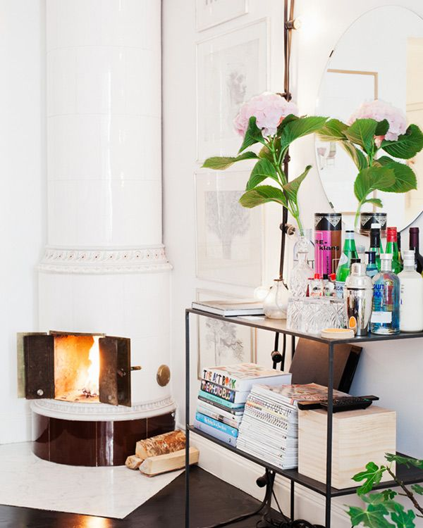 Holiday Home Decor and Decoration Ideas. Fireplace aglow.