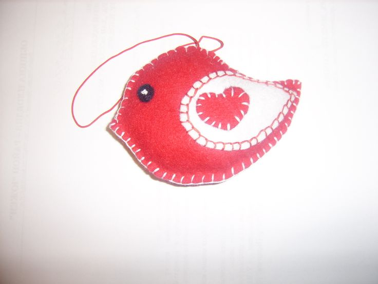 This Toy is made by me from felt, hand sewn and embroidered with cotton thread, filled with recycled wood