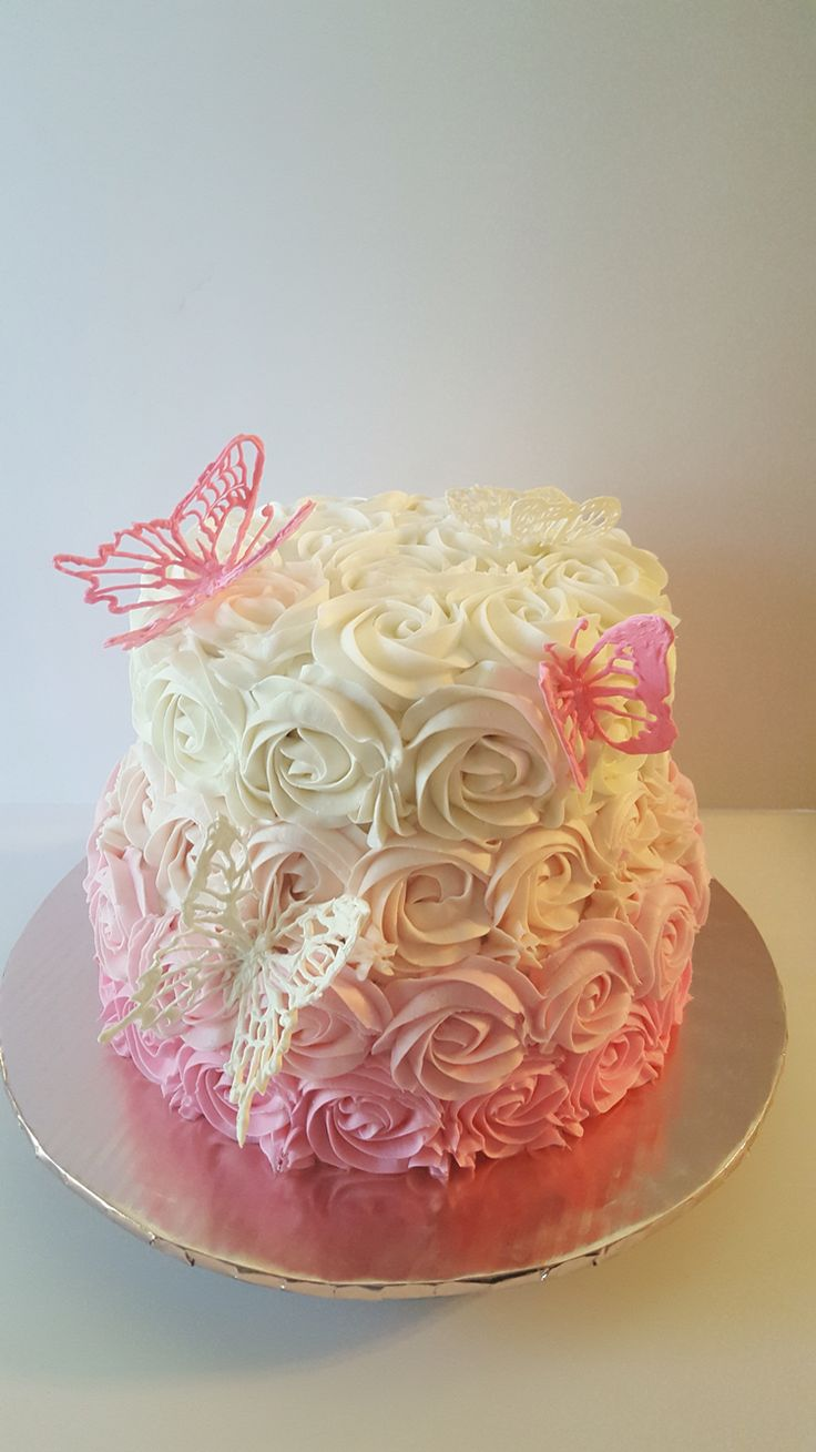 Butterflies rosettes pink and white cake