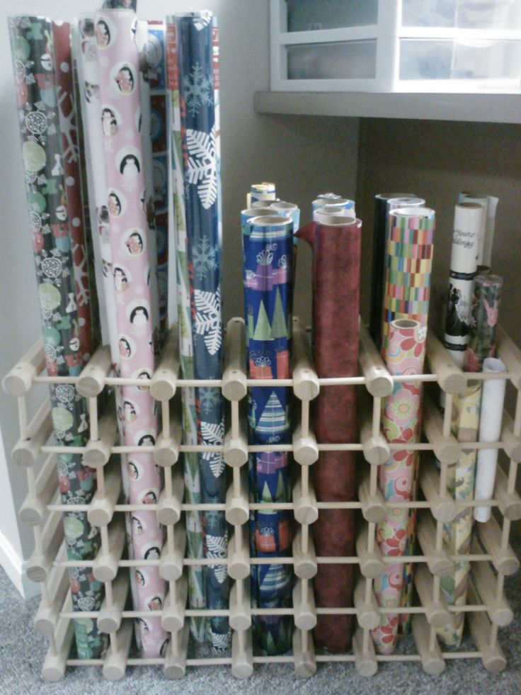 Wine rack for storing wrapping paper rolls.