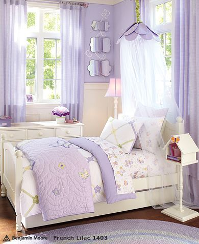 lavender room with chair rail and white furniture