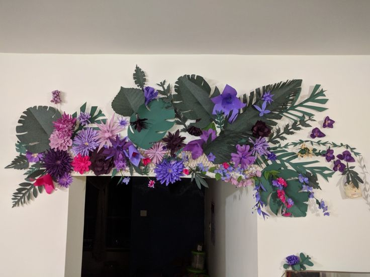 Paper flowers hand made door arch.