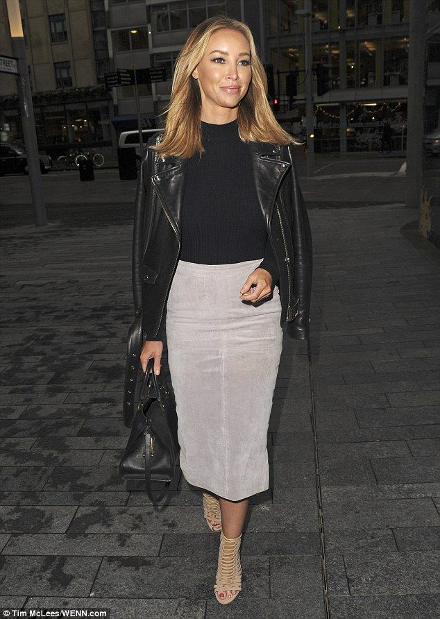 Super chic: Lauren Pope looked gorgeous in a smart midi-length skirt and leather jacket as...