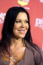 Chyna smiling at event wearing clear star necklace