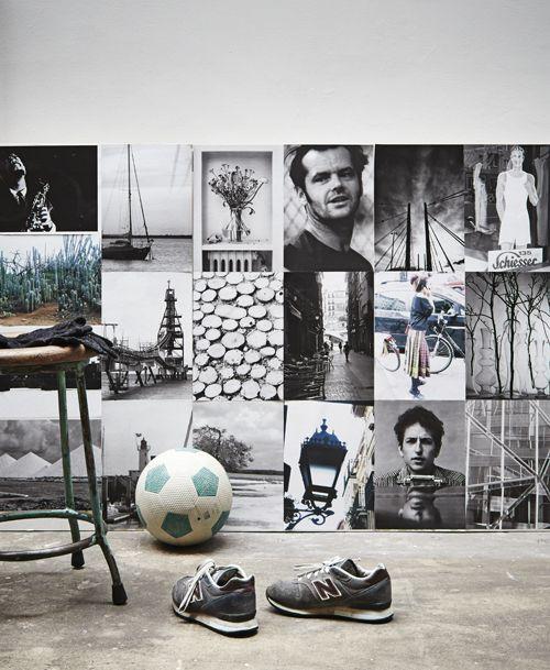 Een muur met zwartwit-foto's