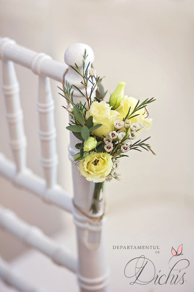 Small floral decoration on beautiful white Chiavari chairs for Weddings.